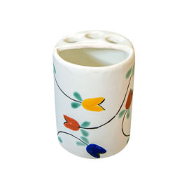 White toothbrush holder with colorful tulip accents
