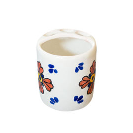 Toothbrush holder with hand painted decorative elements