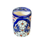 Toothbrush Holder with blue and orange ornamental accents